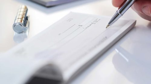 What will happen if a cheque gets bounced and what are the penalties?